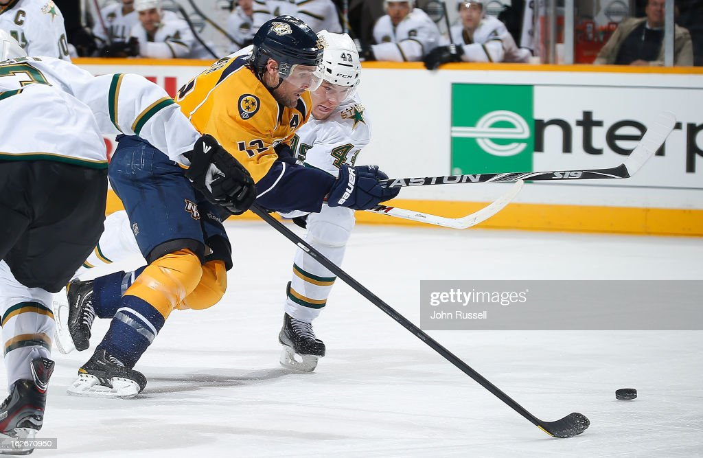 <a gi-track='captionPersonalityLinkClicked' href=/galleries/search?phrase=Mike+Fisher&family=editorial&specificpeople=204732 ng-click='$event.stopPropagation()'>Mike Fisher</a> #12 of the Nashville Predators breaks in the zone to score his 200th career goal against Jamie Oleksiak #43 of the Dallas Stars during an NHL game at the Bridgestone Arena on February 25, 2013 in Nashville, Tennessee.