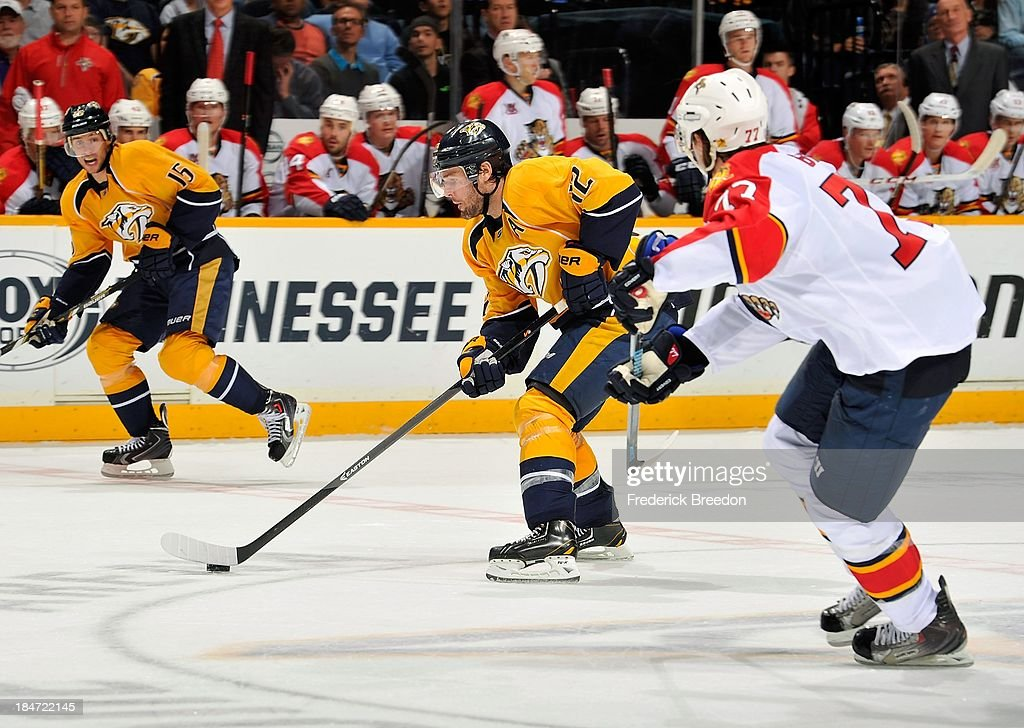 <a gi-track='captionPersonalityLinkClicked' href=/galleries/search?phrase=Mike+Fisher+-+Ice+Hockey+Player&family=editorial&specificpeople=204732 ng-click='$event.stopPropagation()'>Mike Fisher</a> #12 of the Nashville Predators carries the puck into the zone of the Florida Panthers at Bridgestone Arena on October 15, 2013 in Nashville, Tennessee.