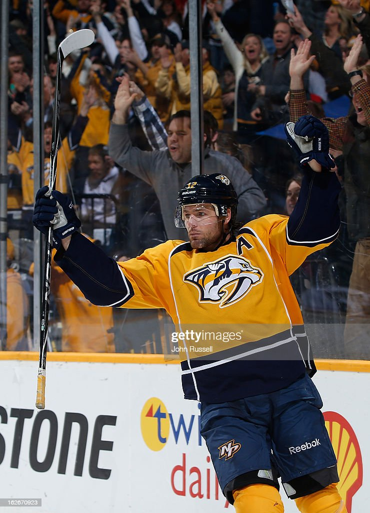 <a gi-track='captionPersonalityLinkClicked' href=/galleries/search?phrase=Mike+Fisher&family=editorial&specificpeople=204732 ng-click='$event.stopPropagation()'>Mike Fisher</a> #12 of the Nashville Predators celebrates his 200th career goal against the Dallas Stars during an NHL game at the Bridgestone Arena on February 25, 2013 in Nashville, Tennessee.