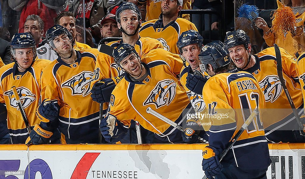 <a gi-track='captionPersonalityLinkClicked' href=/galleries/search?phrase=Mike+Fisher+-+Ice+Hockey+Player&family=editorial&specificpeople=204732 ng-click='$event.stopPropagation()'>Mike Fisher</a> #12 of the Nashville Predators celebrates his goal along the bench against the Detroit Red Wings at Bridgestone Arena on December 30, 2013 in Nashville, Tennessee.