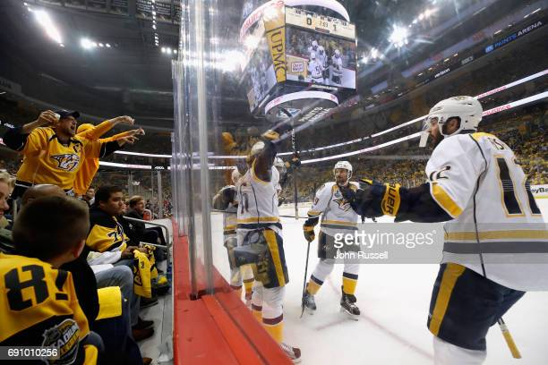 Mike Fisher of the Nashville Predators celebrates with teammates after Pontus Aberg scored a first period goal in Game Two of the 2017 NHL Stanley...