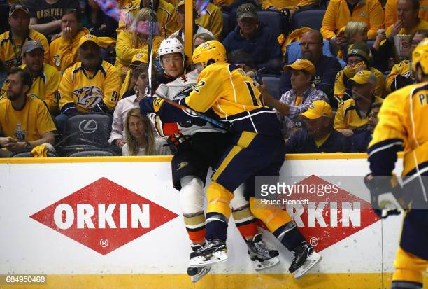 Mike Fisher of the Nashville Predators checks Brandon Montour of the Anaheim Ducks during the third period in Game Four of the Western Conference...
