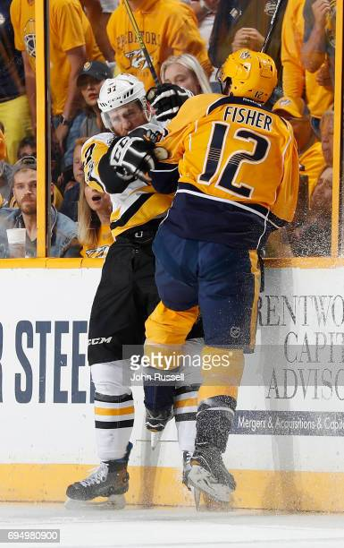 Mike Fisher of the Nashville Predators collides with Carter Rowney of the Pittsburgh Penguins during Game Six of the 2017 NHL Stanley Cup Final at...