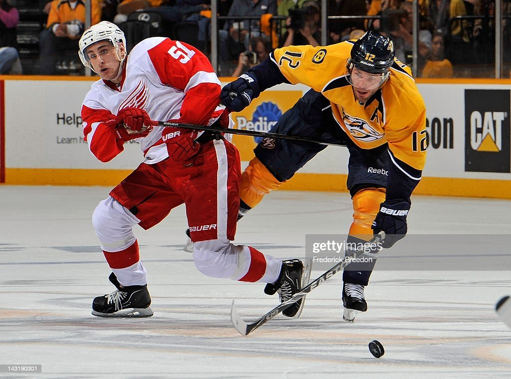 <a gi-track='captionPersonalityLinkClicked' href=/galleries/search?phrase=Mike+Fisher+-+Ice+Hockey+Player&family=editorial&specificpeople=204732 ng-click='$event.stopPropagation()'>Mike Fisher</a> #12 of the Nashville Predators collides with <a gi-track='captionPersonalityLinkClicked' href=/galleries/search?phrase=Valtteri+Filppula&family=editorial&specificpeople=2234404 ng-click='$event.stopPropagation()'>Valtteri Filppula</a> #51 of the Detroit Red Wings in Game Five of the Western Conference Quarterfinals during the 2012 NHL Stanley Cup Playoffs at the Bridgestone Arena on April 20, 2012 in Nashville, Tennessee.