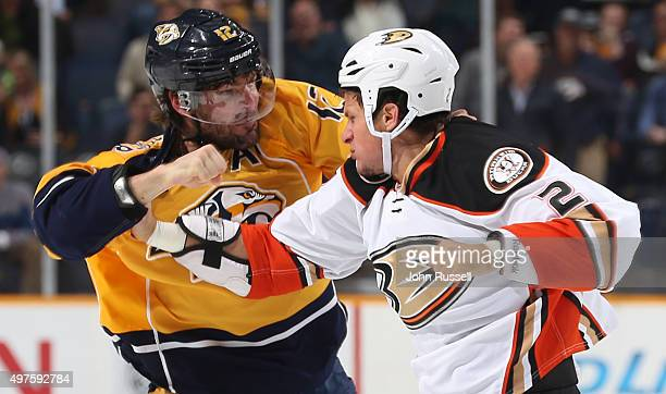 Mike Fisher of the Nashville Predators drops the gloves against Kevin Bieksa of the Anaheim Ducks during an NHL game at Bridgestone Arena on November...