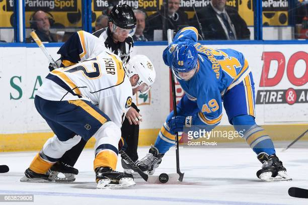 Mike Fisher of the Nashville Predators faces off against Ivan Barbashev of the St Louis Blues during the game on April 2 2017 at Scottrade Center in...