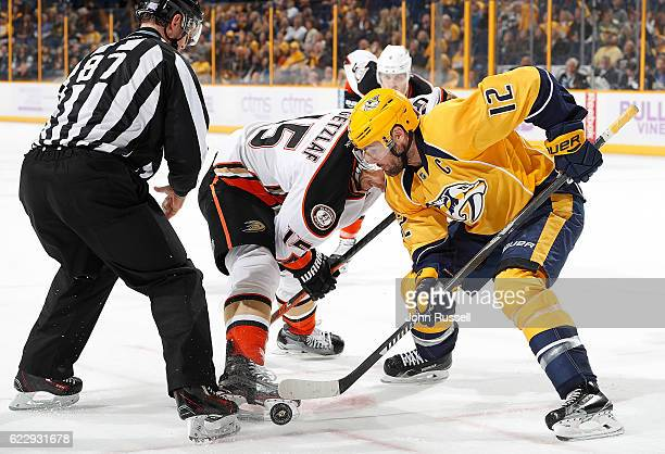 Mike Fisher of the Nashville Predators faces off against Ryan Getzlaf of the Anaheim Ducks during an NHL game at Bridgestone Arena on November 12...