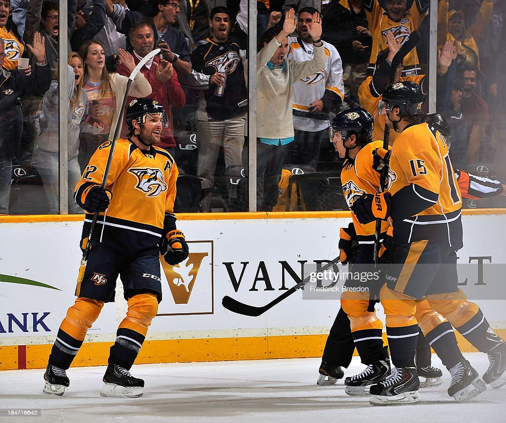 Mike Fisher #12 of the Nashville Predators is congratulated by teammates on scoring a goal against the Florida Panthers at Bridgestone Arena on October 15, 2013 in Nashville, Tennessee.