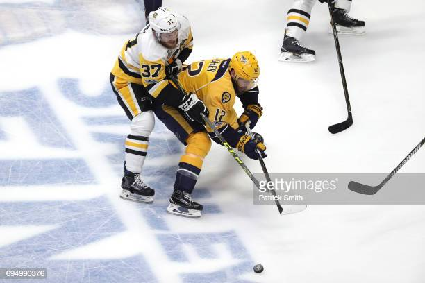Mike Fisher of the Nashville Predators is defended by Carter Rowney of the Pittsburgh Penguins during the first period in Game Six of the 2017 NHL...