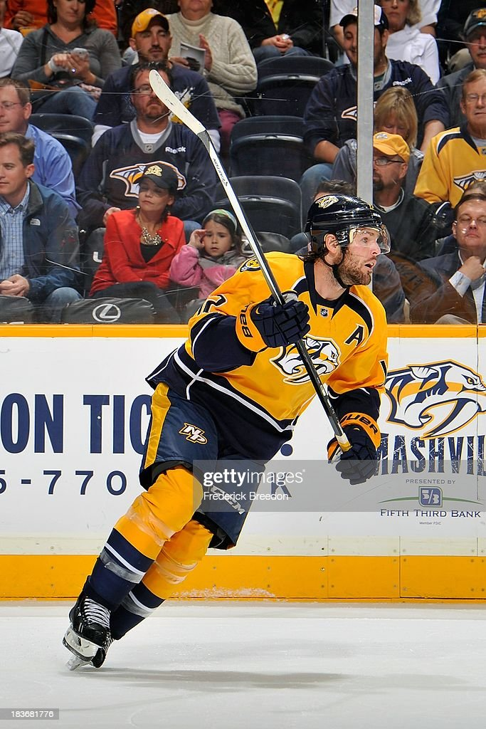 <a gi-track='captionPersonalityLinkClicked' href=/galleries/search?phrase=Mike+Fisher&family=editorial&specificpeople=204732 ng-click='$event.stopPropagation()'>Mike Fisher</a> #12 of the Nashville Predators plays against the Minnesota Wild at Bridgestone Arena on October 8, 2013 in Nashville, Tennessee.