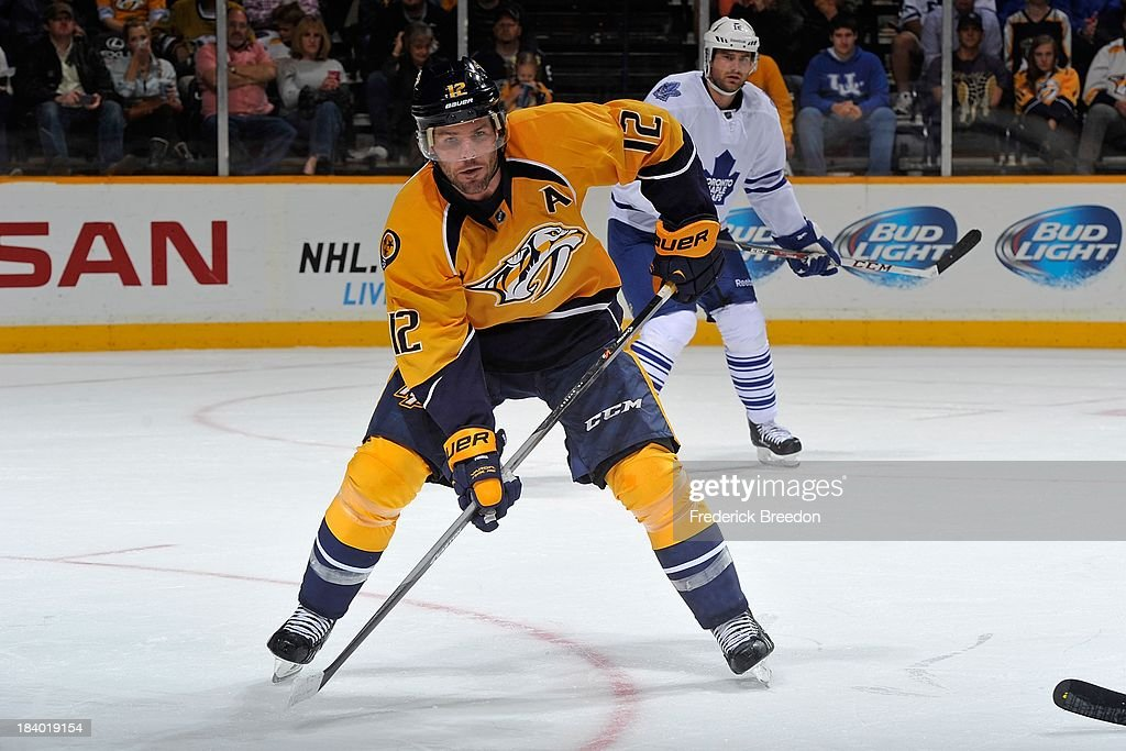 Mike Fisher #12 of the Nashville Predators plays against the Toronto Maple Leafs at Bridgestone Arena on October 10, 2013 in Nashville, Tennessee.