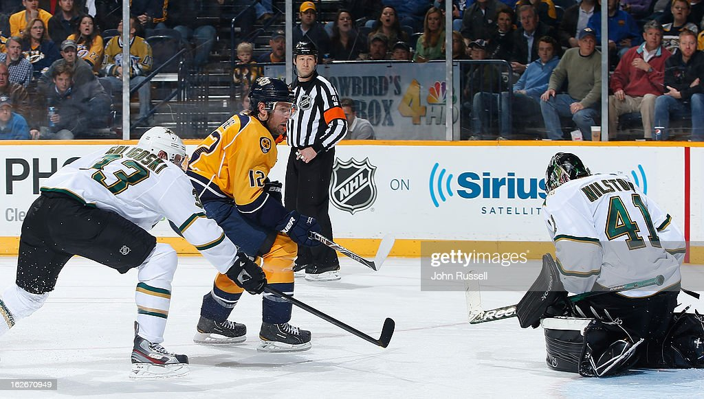 <a gi-track='captionPersonalityLinkClicked' href=/galleries/search?phrase=Mike+Fisher&family=editorial&specificpeople=204732 ng-click='$event.stopPropagation()'>Mike Fisher</a> #12 of the Nashville Predators scores his 200th career goal against Cristopher Nilstorp #41 of the Dallas Stars during an NHL game at the Bridgestone Arena on February 25, 2013 in Nashville, Tennessee.