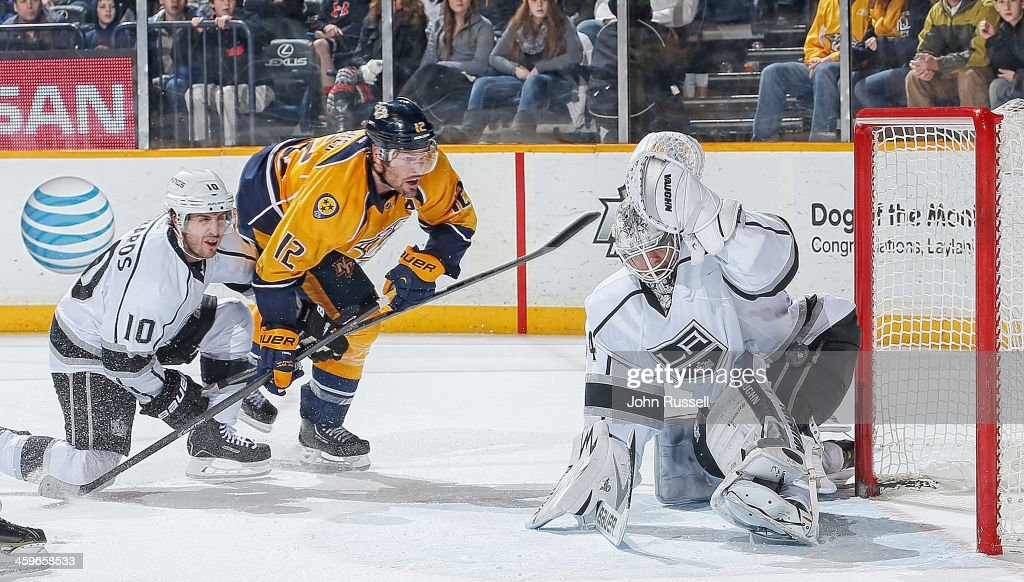 <a gi-track='captionPersonalityLinkClicked' href=/galleries/search?phrase=Mike+Fisher&family=editorial&specificpeople=204732 ng-click='$event.stopPropagation()'>Mike Fisher</a> #12 of the Nashville Predators scores the game-winner against <a gi-track='captionPersonalityLinkClicked' href=/galleries/search?phrase=Ben+Scrivens&family=editorial&specificpeople=7185205 ng-click='$event.stopPropagation()'>Ben Scrivens</a> #54 of the Los Angeles Kings at Bridgestone Arena on December 28, 2013 in Nashville, Tennessee.