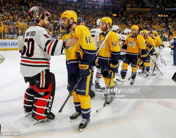Mike Fisher of the Nashville Predators shakes hands with Corey Crawford of the Chicago Blackhawks after a 41 series win in Game Four of the Western...
