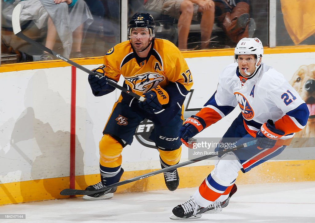 <a gi-track='captionPersonalityLinkClicked' href=/galleries/search?phrase=Mike+Fisher&family=editorial&specificpeople=204732 ng-click='$event.stopPropagation()'>Mike Fisher</a> #12 of the Nashville Predators skates against <a gi-track='captionPersonalityLinkClicked' href=/galleries/search?phrase=Kyle+Okposo&family=editorial&specificpeople=540469 ng-click='$event.stopPropagation()'>Kyle Okposo</a> #21 of the New York Islanders at Bridgestone Arena on October 12, 2013 in Nashville, Tennessee.
