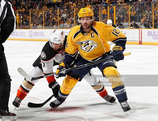 Mike Fisher of the Nashville Predators skates against Ryan Kesler of the Anaheim Ducks during an NHL game at Bridgestone Arena on November 12 2016 in...