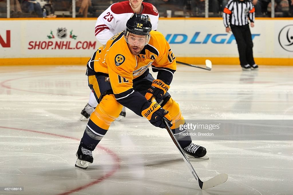 <a gi-track='captionPersonalityLinkClicked' href=/galleries/search?phrase=Mike+Fisher&family=editorial&specificpeople=204732 ng-click='$event.stopPropagation()'>Mike Fisher</a> #12 of the Nashville Predators skates against the Phoenix Coyotes at Bridgestone Arena on November 25, 2013 in Nashville, Tennessee.