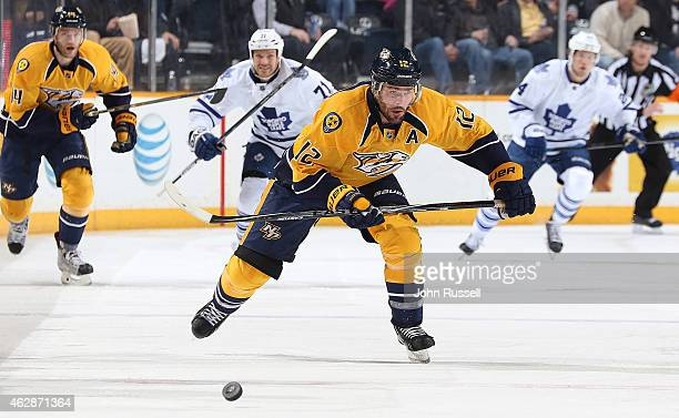 Mike Fisher of the Nashville Predators skates against the Toronto Maple Leafs during an NHL game at Bridgestone Arena on February 3 2015 in Nashville...