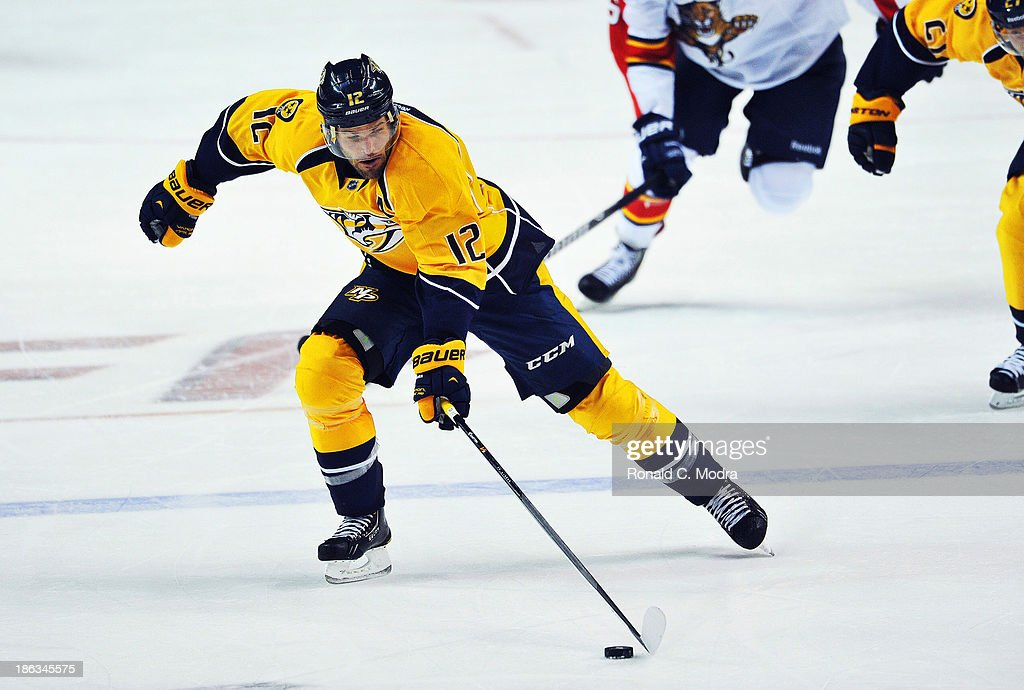Mike Fisher #12 of the Nashville Predators skates with the puck against the Florida Panthers at Bridgestone Arena on October 15, 2013 in Nashville, Tennessee.