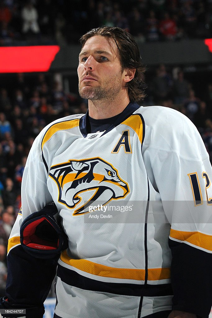 Mike Fisher #12 of the Nashville Predators stands for the singing of the national anthem prior to a game against the Edmonton Oilers on March 17, 2013 at Rexall Place in Edmonton, Alberta, Canada.