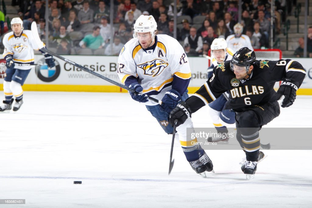 <a gi-track='captionPersonalityLinkClicked' href=/galleries/search?phrase=Mike+Fisher+-+Ice+Hockey+Player&family=editorial&specificpeople=204732 ng-click='$event.stopPropagation()'>Mike Fisher</a> #12 of the Nashville Predators tries to keep the puck away against <a gi-track='captionPersonalityLinkClicked' href=/galleries/search?phrase=Trevor+Daley&family=editorial&specificpeople=213975 ng-click='$event.stopPropagation()'>Trevor Daley</a> #6 of the Dallas Stars at the American Airlines Center on March 12, 2013 in Dallas, Texas.