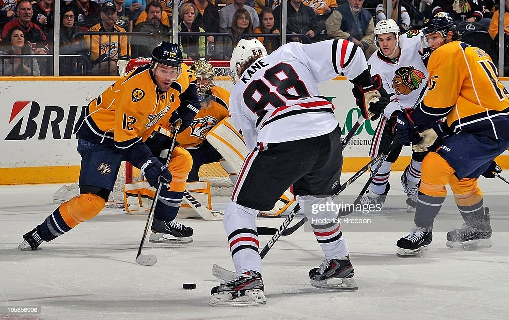 <a gi-track='captionPersonalityLinkClicked' href=/galleries/search?phrase=Mike+Fisher&family=editorial&specificpeople=204732 ng-click='$event.stopPropagation()'>Mike Fisher</a> #12 of the Nashville Predators watches Patrick Kane #88 of the Chicago Blackhawks at the Bridgestone Arena on April 6, 2013 in Nashville, Tennessee.