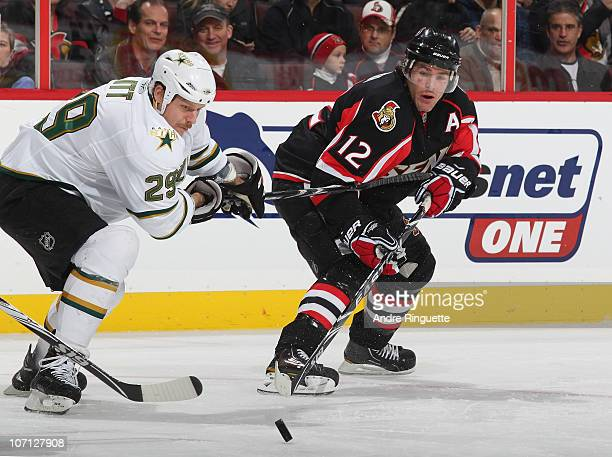 Mike Fisher of the Ottawa Senators battles for puck possession with Steve Ott of the Dallas Stars at Scotiabank Place on November 24 2010 in Ottawa...