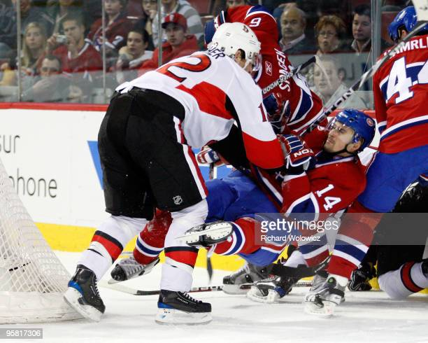 Mike Fisher of the Ottawa Senators shoves Tomas Plekanec of the Montreal Canadiens during the NHL game on January 16 2010 at the Bell Centre in...