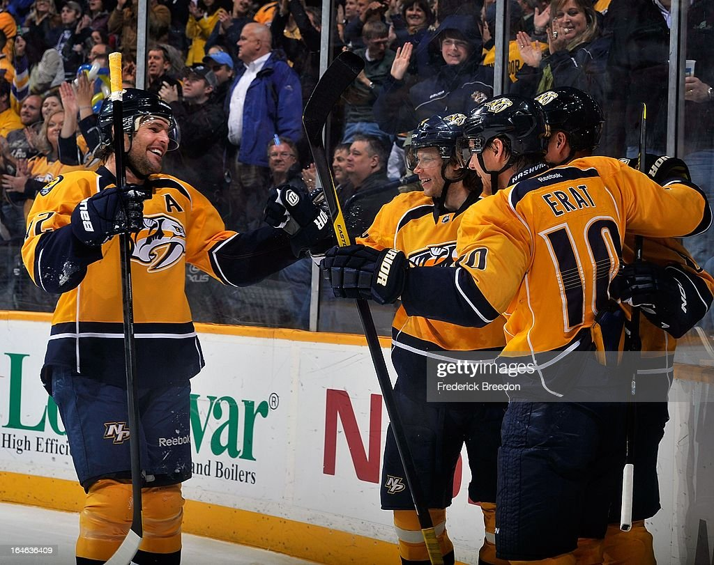 Mike Fisher #12,Sergei Kostitsyn #74, and Martin Erat #10 of the Nashville Predators celebrate a goal against the Edmonton Oilers at the Bridgestone Arena on March 25, 2013 in Nashville, Tennessee.