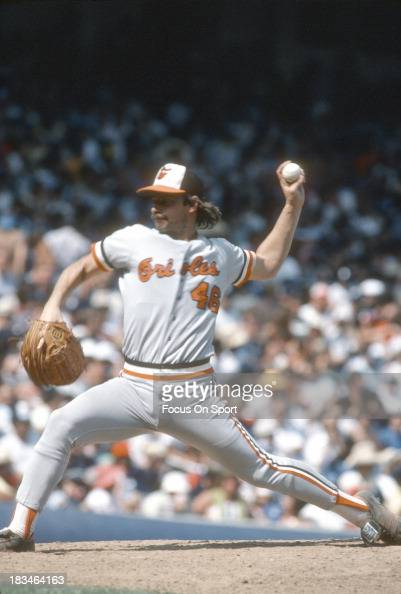 Mike Flanagan of the Baltimore Orioles pitches against the New York Yankees during a Major League Baseball game circa 1980 at Yankee Stadium in the...