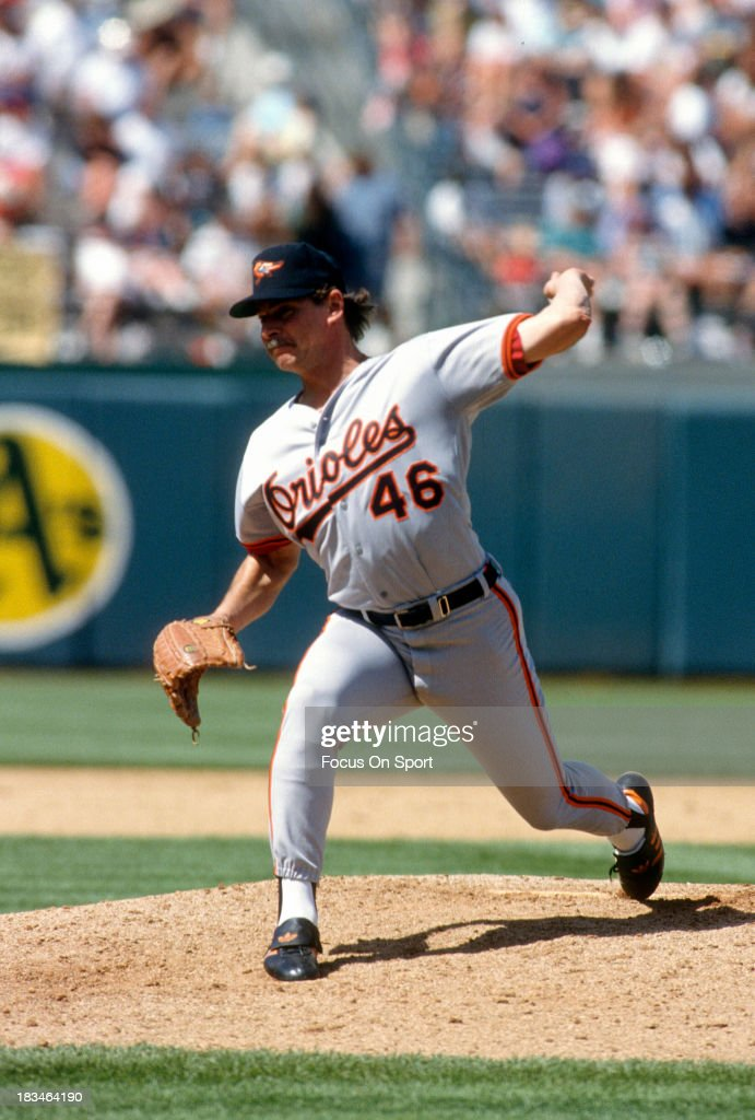 Mike Flanagan of the Baltimore Orioles pitches against the Oakland Athletics during a Major League Baseball game circa 1992 at the OaklandAlameda...