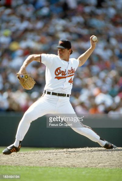 Mike Flanagan of the Baltimore Orioles pitches during a Major League Baseball game circa 1992 at Orioles Park at Camden Yards in Baltimore Maryland...