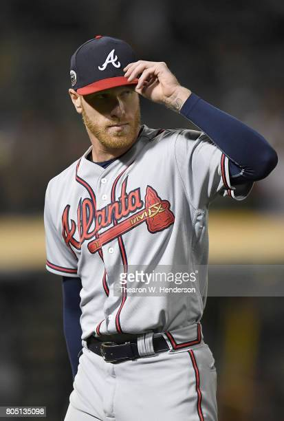 Mike Foltynewicz of the Atlanta Braves tips his hat to the fans as he leaves the game against the Oakland Athletics in the bottom of the ninth inning...