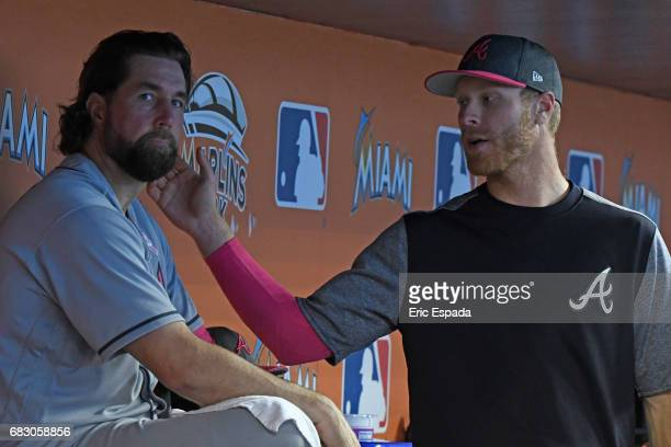 Mike Foltynewicz of the Atlanta Braves with RA Dickey in the dugout after giving up a 3run home run in the seventh inning against the Miami Marlins...