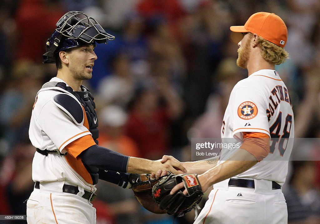 Mike Foltynewicz #48 of the Houston Astros shakes hands with Jason Castro #15 after the final out against the Texas Rangers at Minute Maid Park on August 9, 2014 in Houston, Texas. Houston won 8-3.