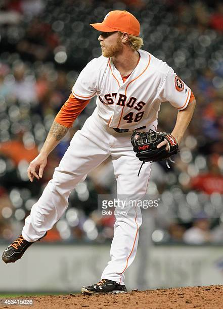 Mike Foltynewicz of the Houston Astros throws in the ninth inning against the Texas Rangers at Minute Maid Park on August 9 2014 in Houston Texas...