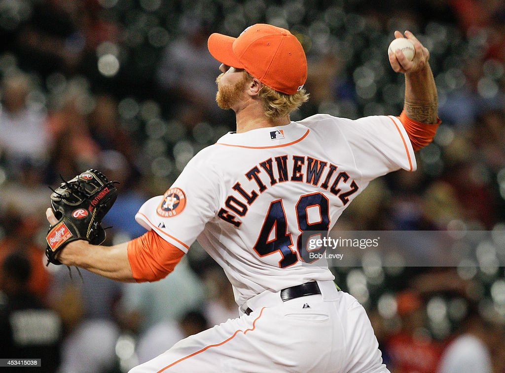 Mike Foltynewicz #48 of the Houston Astros throws in the ninth inning against the Texas Rangers at Minute Maid Park on August 9, 2014 in Houston, Texas. Houston won 8-3