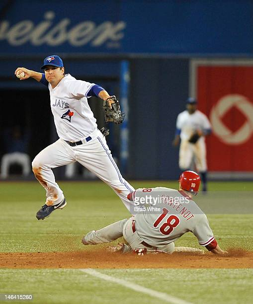 Mike Fontenot of the Philadelphia Phillies is forced out at second by Kelly Johnson of the Toronto Blue Jays during interleague MLB game action June...