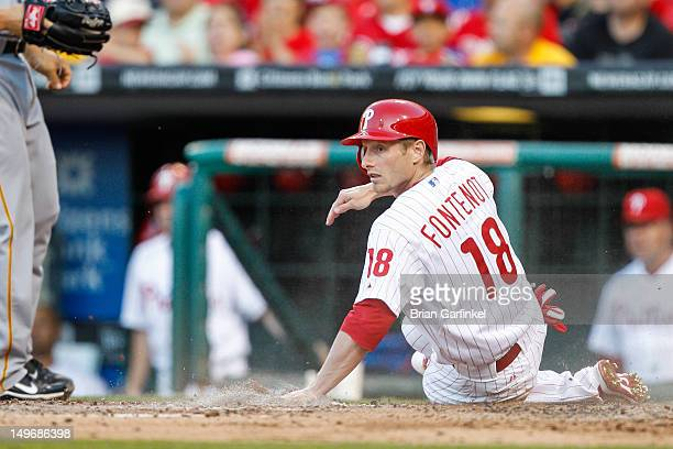 Mike Fontenot of the Philadelphia Phillies looks back after scoring a run during the game against the Pittsburgh Pirates at Citizens Bank Park on...