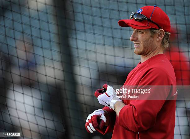 Mike Fontenot of the Philadelphia Phillies looks on during batting practice before the game against the Minnesota Twins on June 12 2012 at Target...