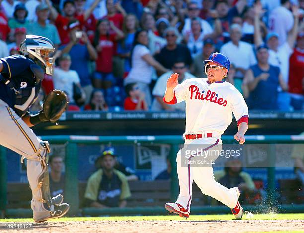 Mike Fontenot of the Philadelphia Phillies races home as he scores the game winning run on a single by teammate Jimmy Rollins in the 10th inning off...