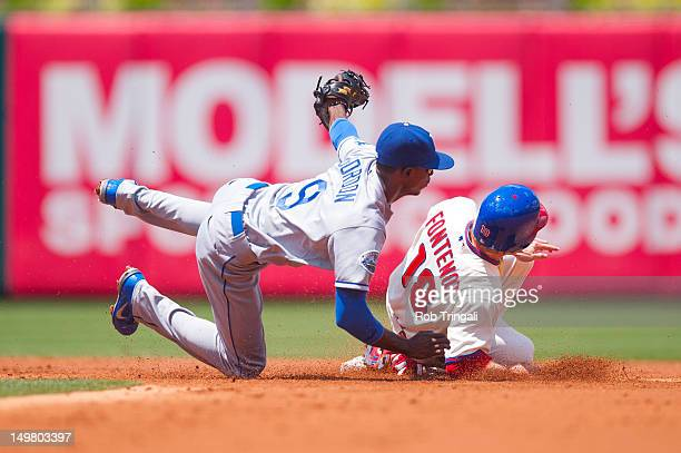 Mike Fontenot of the Philadelphia Phillies slides into second as Dee Gordon of the Los Angeles Dodgers puts the tag on him during the game between...
