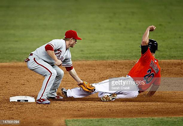 Mike Fontenot of the Philadelphia Phillies tags out Justin Ruggiano of the Miami Marlins during a game at Marlins Park on July 1 2012 in Miami...