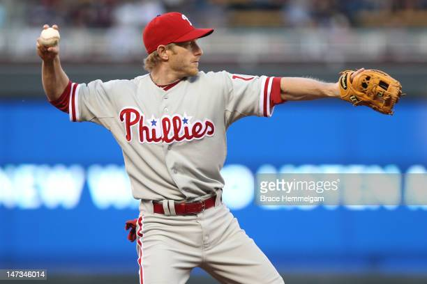 Mike Fontenot of the Philadelphia Phillies throws against the Minnesota Twins on June 12 2012 at Target Field in Minneapolis Minnesota The Twins...