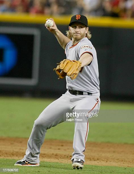 Mike Fontenot of the San Francisco Giants makes a throw to first base on a ground ball against the Arizona Diamondbacks during a Major League...