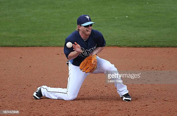 Mike Fontenot of the Tampa Bay Rays attempts to make the play as the ball bounces off his chest into left field during the game against the...