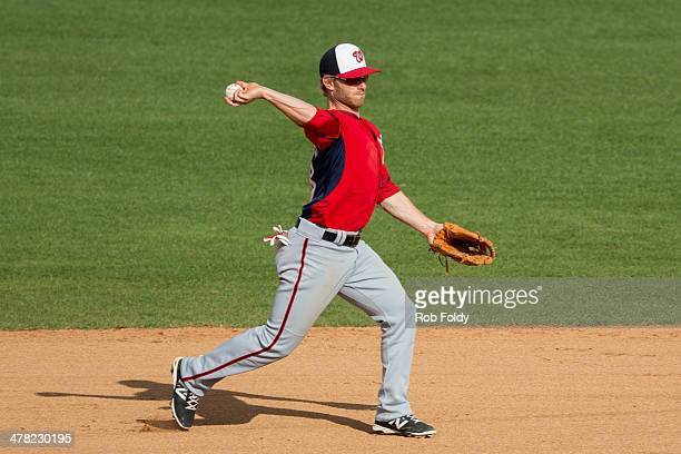 Mike Fontenot of the Washington Nationals throws to first base during the spring training game against the Houston Astros at Osceola County Stadium...