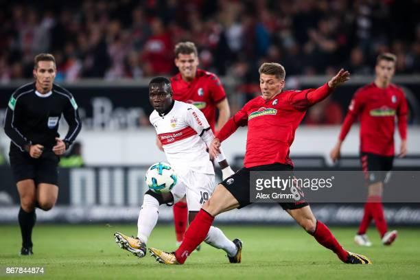 Mike Frantz of Freiburg and Chadrac Akolo of Stuttgart battle for the ball during the Bundesliga match between VfB Stuttgart and SportClub Freiburg...