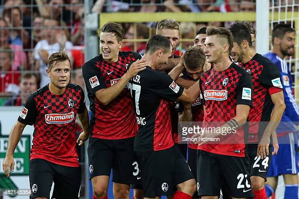 Mike Frantz of Freiburg celebrates his team's fourth goal with team mates during the 2 Bundesliga match between SC Freiburg and 1 FC Nuernberg at...