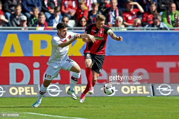 Mike Frantz of Freiburg fights for the ball with Kevin Volland of Leverkusen during the Bundesliga match between SC Freiburg and Bayer 04 Leverkusen...
